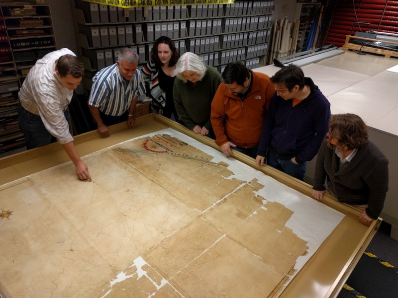 The Witte Museum team inspects the Austin map. Photo courtesy of the Witte.