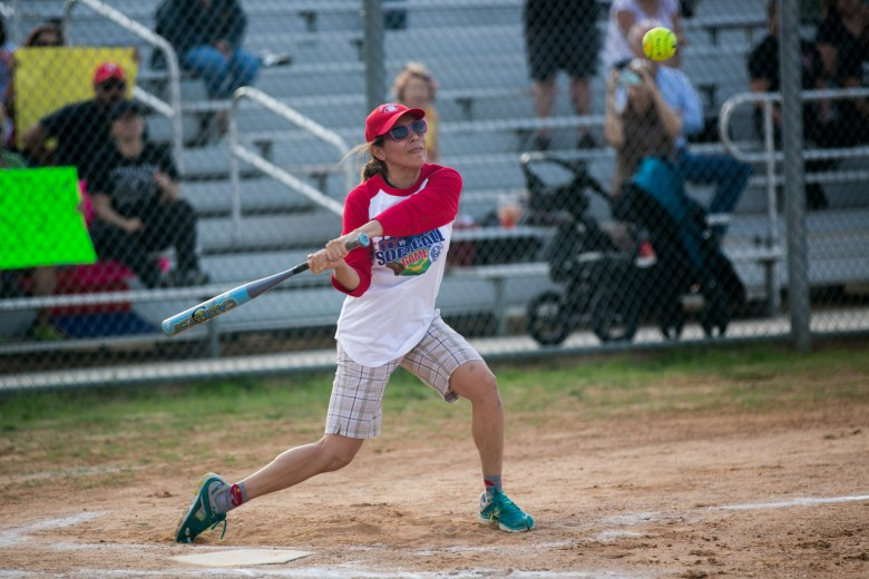 Former City Council member Shirley Gonzales swings at a pitch during a City vs. County softball game in 2016.