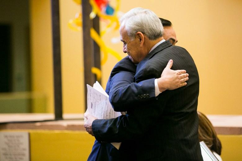 Former U.S Rep. Charles Gonzalez, hugs U.S. Rep. Joaquin Castro. Photo by Kathryn Boyd-Batstone.