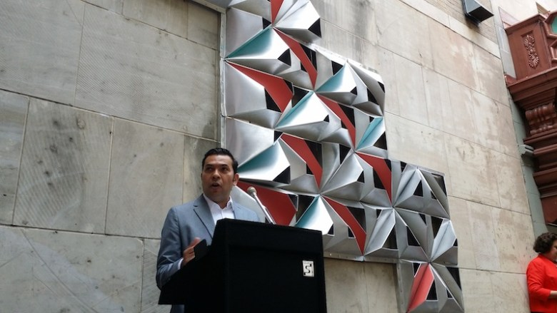 "UTSA Architecture and Interior Design Lecturer Armando Araiza praises his student for their work on ""Morf."" Photo by Iris Dimmick."