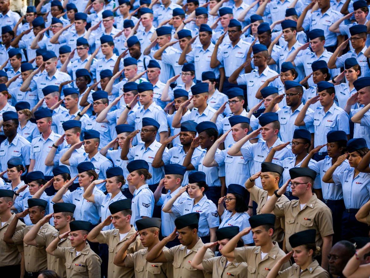 Members of US Air Force Academy salute the American Flag during the National Anthem. Photo by Kathryn Boyd-Batstone