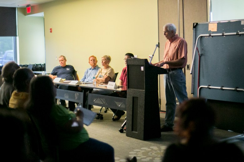 Gerald Hess speaks about the impacts of tourism on the area. Photo by Kathryn Boyd-Batstone