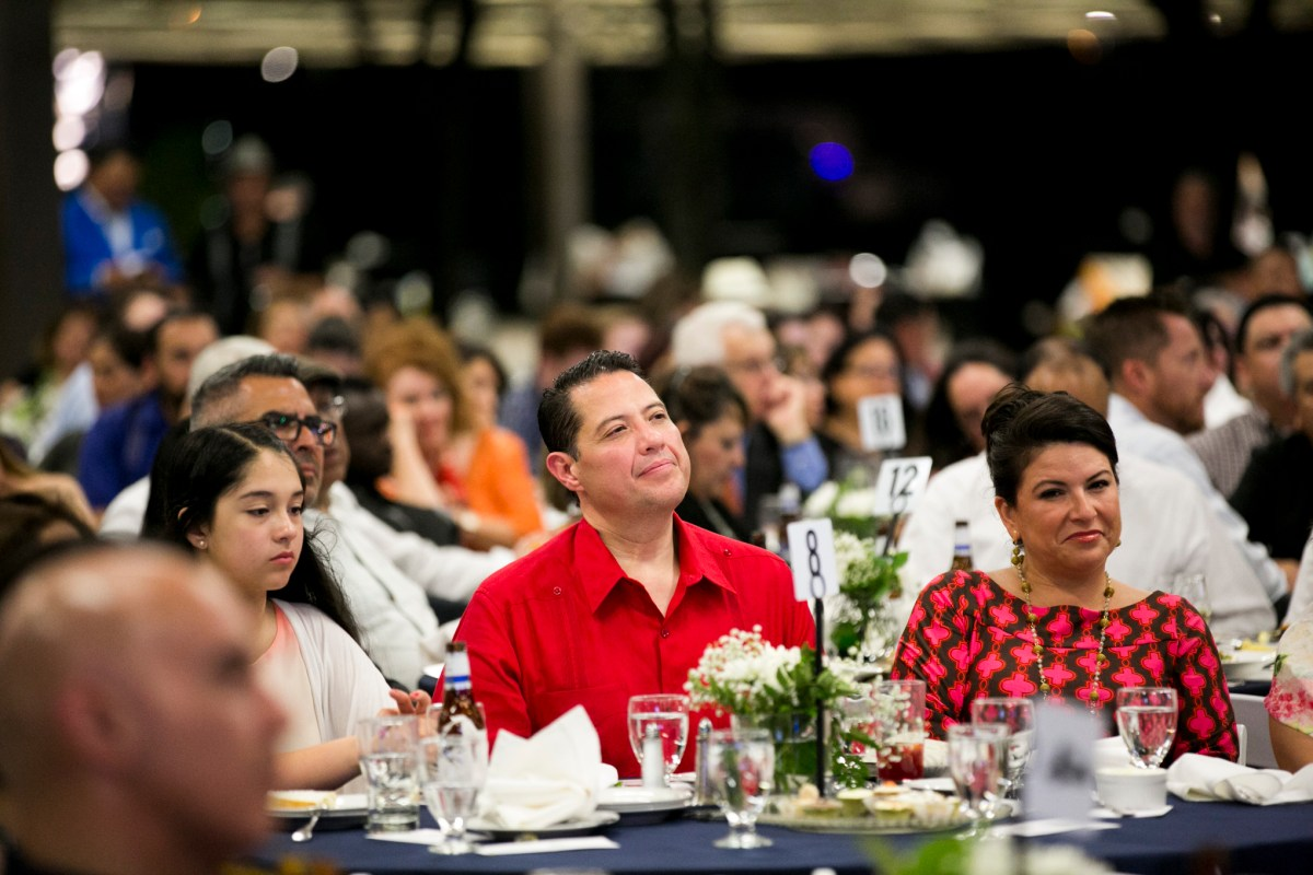 The Cortez family, of the restaurant Mi Tierra, await to receive their award for service to the Westside. Photo by Kathryn Boyd-Batstone.