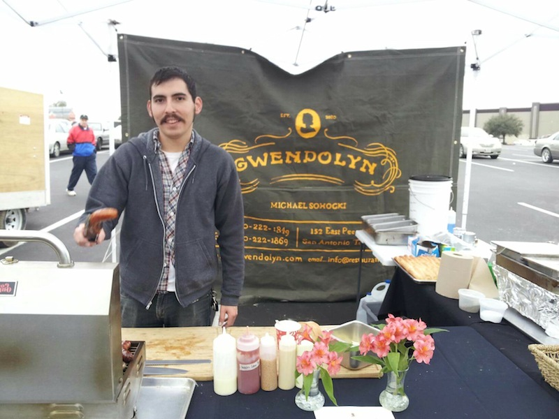 Former Restaurant Gwendolyn Sous Chef Dave Rizo mans the tent during the Pearl Farmers Market. Photo by Kyle Destefano.