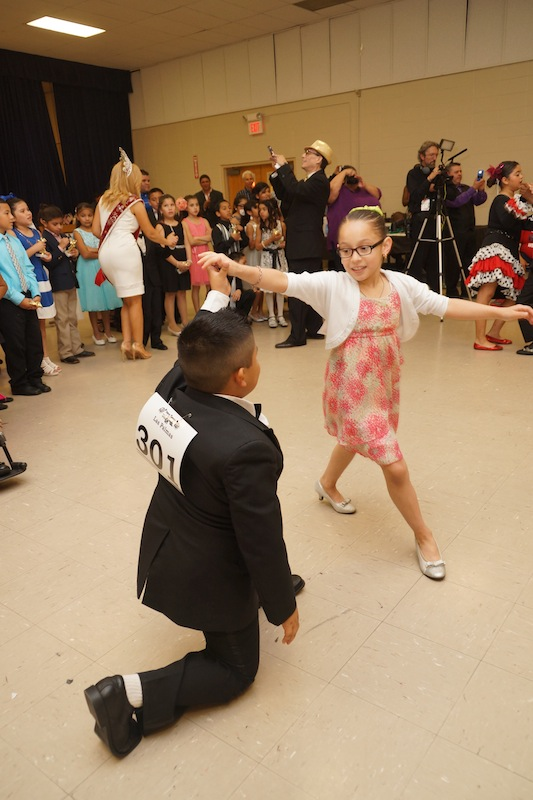 A couple competes at the Edgewood ISD district-wide ballroom dancing competition. Photo courtesy of Nuvo Multimedia.