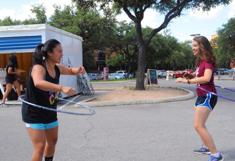 L to R: Trinity sophomores Hester Lee and Claire Burrus break out hula hoops and jump ropes at the Trinity Farmer's Market. Photo by Lea Thompson