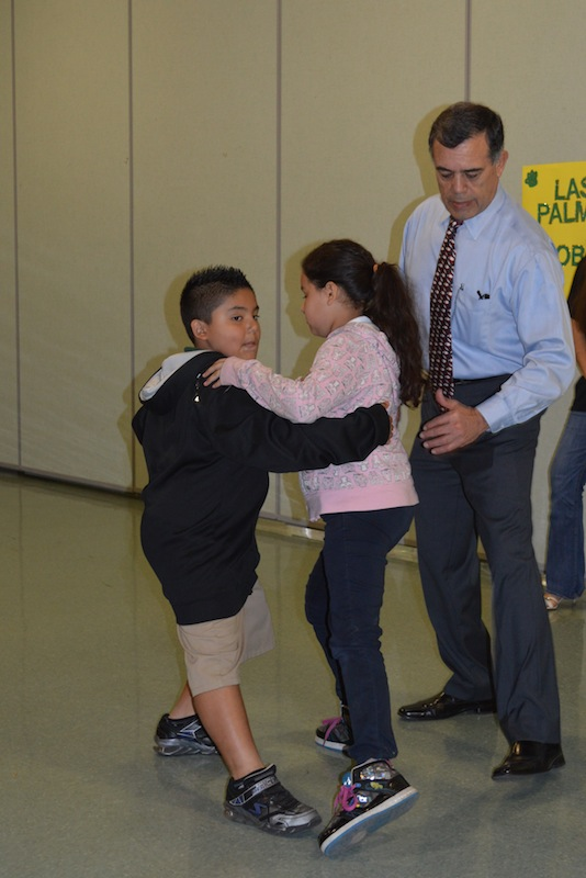 Robert Ramirez, dance instructor, instructs a couple on a tango movement. Photo by Ramon Hernandez.