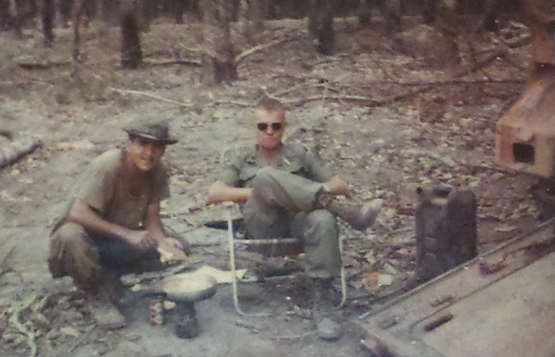"""Sgt. Fernando Herrera (left) prepares lunch for his company commander from a """"care package"""" of food sent by Fernando's mother and grandmother, circa 1968. Photo courtesy of Sgt. Fernando Herrera."""