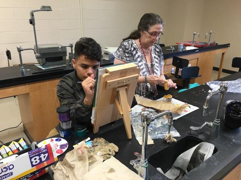 Oscar Pinedo (l) and his teacher Annette Hoffman working in the Highlands High School art studio after school. Photo by Bekah McNeel