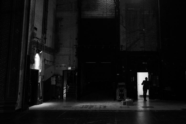 Guitarist Roland Delacruz leans in a doorway as Buttercup practices. Photo by Scott Ball.