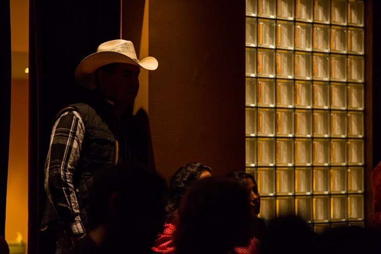 A man in cowboy hat, naturally representative of the Conjunto crowd, quietly takes in the performance. Photo courtesy of Scott Ball