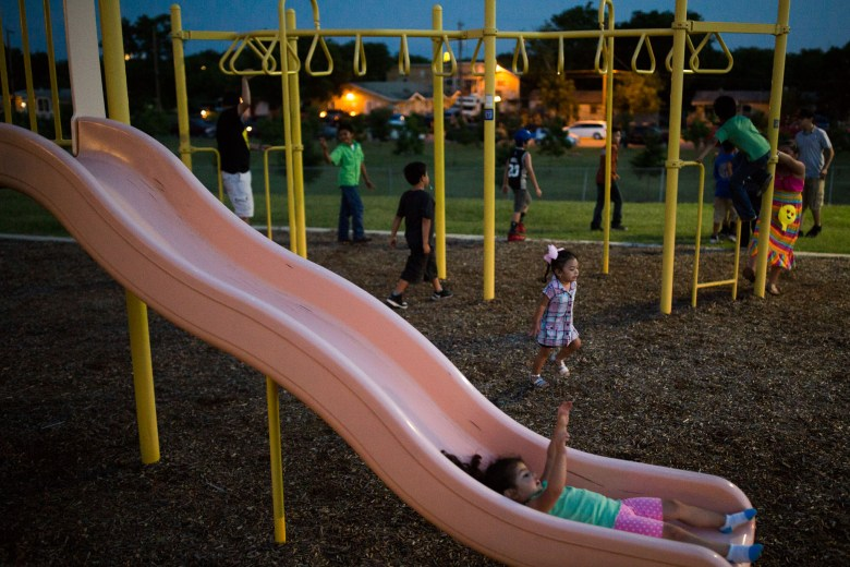 Children play at the nearby playground at Rosedale Park. Photo by Scott Ball.