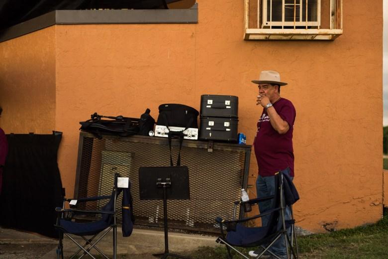 Mario Diaz takes a break nearby band equipment. Photo by Scott Ball.