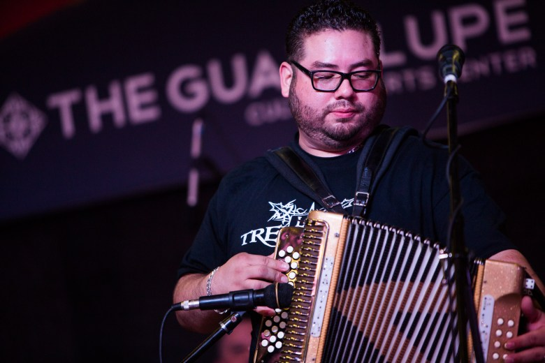 The accordion player from Los Tremendos V plays his instrument. Photo by Scott Ball.