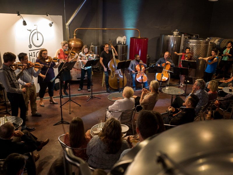 A concert led by Concertmaster Eric Gratz by the Musicians of the San Antonio Symphony at Dor?ol Distilling Company. Photo by Scott Ball.