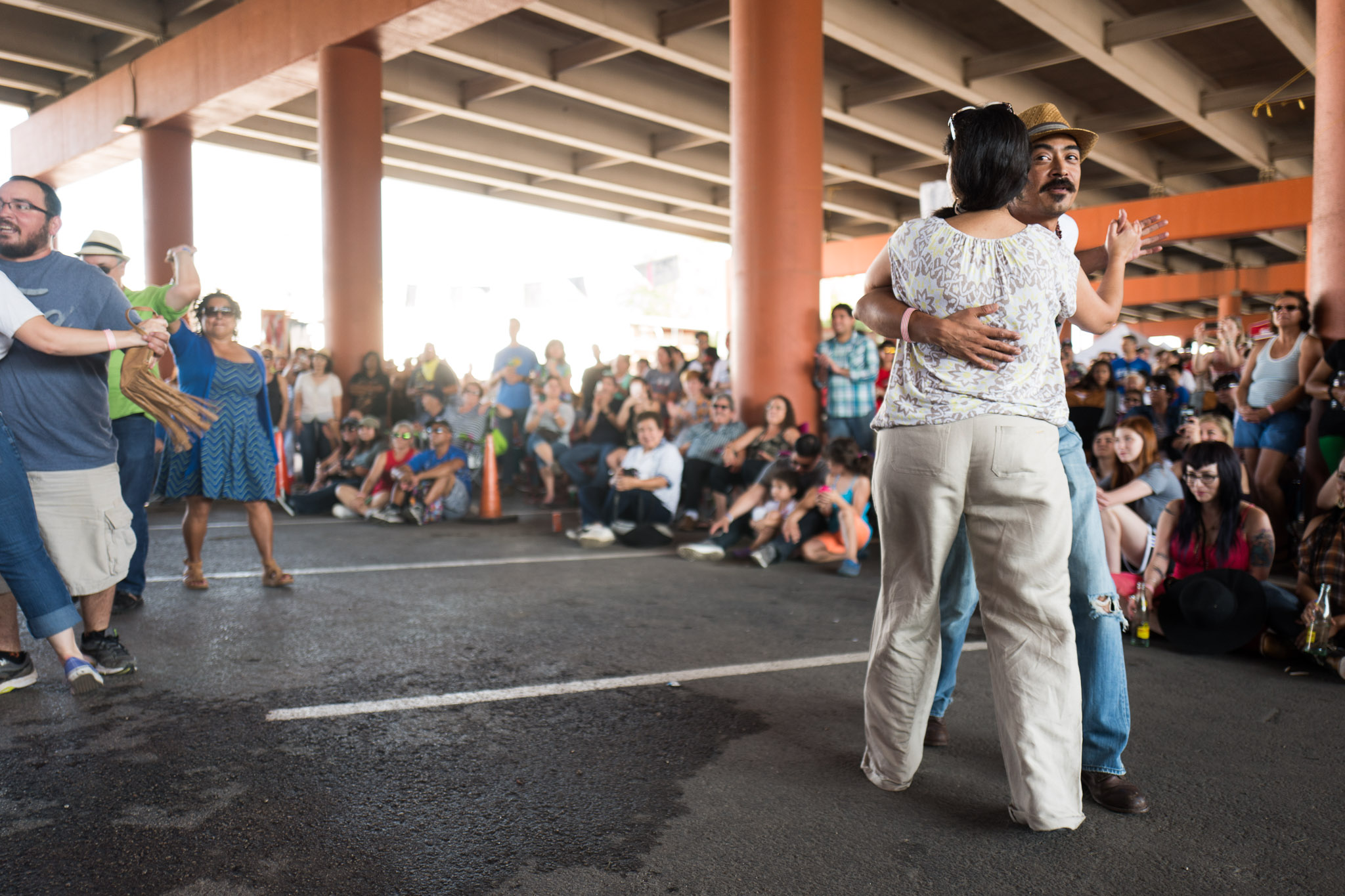 Local artist Nicolás Valdez is the first to take to the dance floor. Photo by Scott Ball.