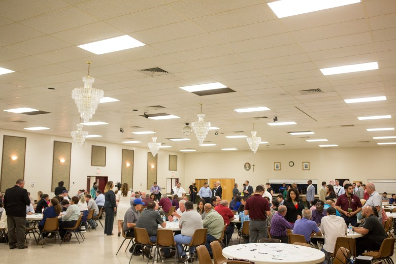 Round tables filled with community members, rideshare drivers, taxi drivers, and public officials meet to discuss ride share in San Antonio. Photo by Scott Ball.