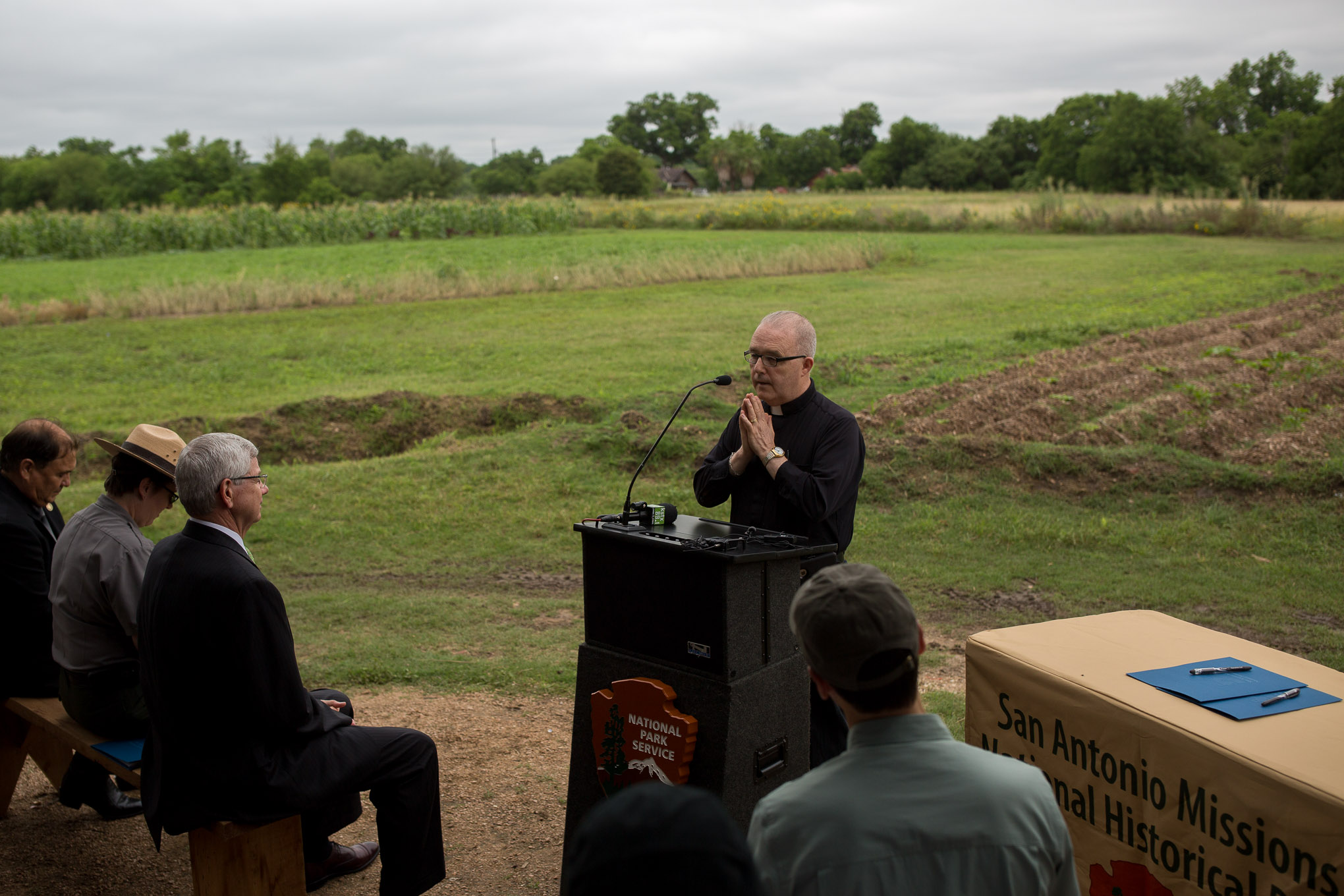 Reverend James Galvin says a prayer at the press conference. Photo by Scott Ball.
