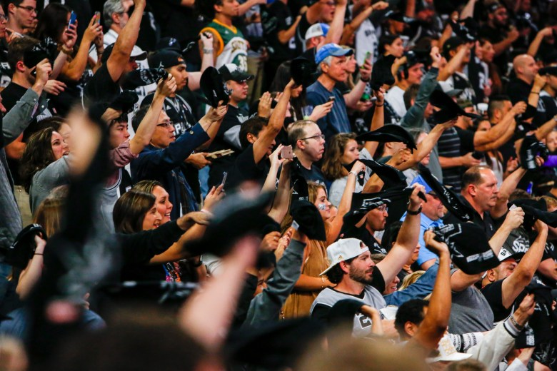 Spurs fans wave towels given to each ticket holder. Photo by Scott Ball.