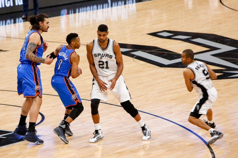 Spurs Guard #9 Tony Parker moves around Tim Duncan during a play. Photo by Scott Ball.