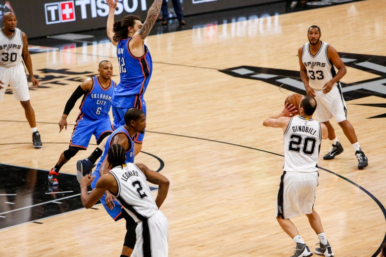 Spurs Forward #20 Manu Ginobili fakes a shot as Thunder Center #12 Steven Adams jumps in defense. Photo by Scott Ball.