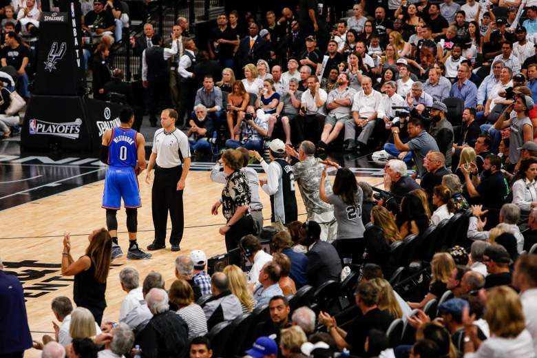 Thunder Guard #0 Russell Westbrook talks with an official as fans shout and disrupt him. Photo by Scott Ball.