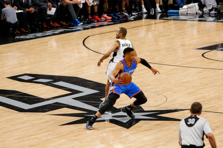 Thunder Guard #0 Russell Westbrook spins around Spurs Guard #9 Tony Parker. Photo by Scott Ball.