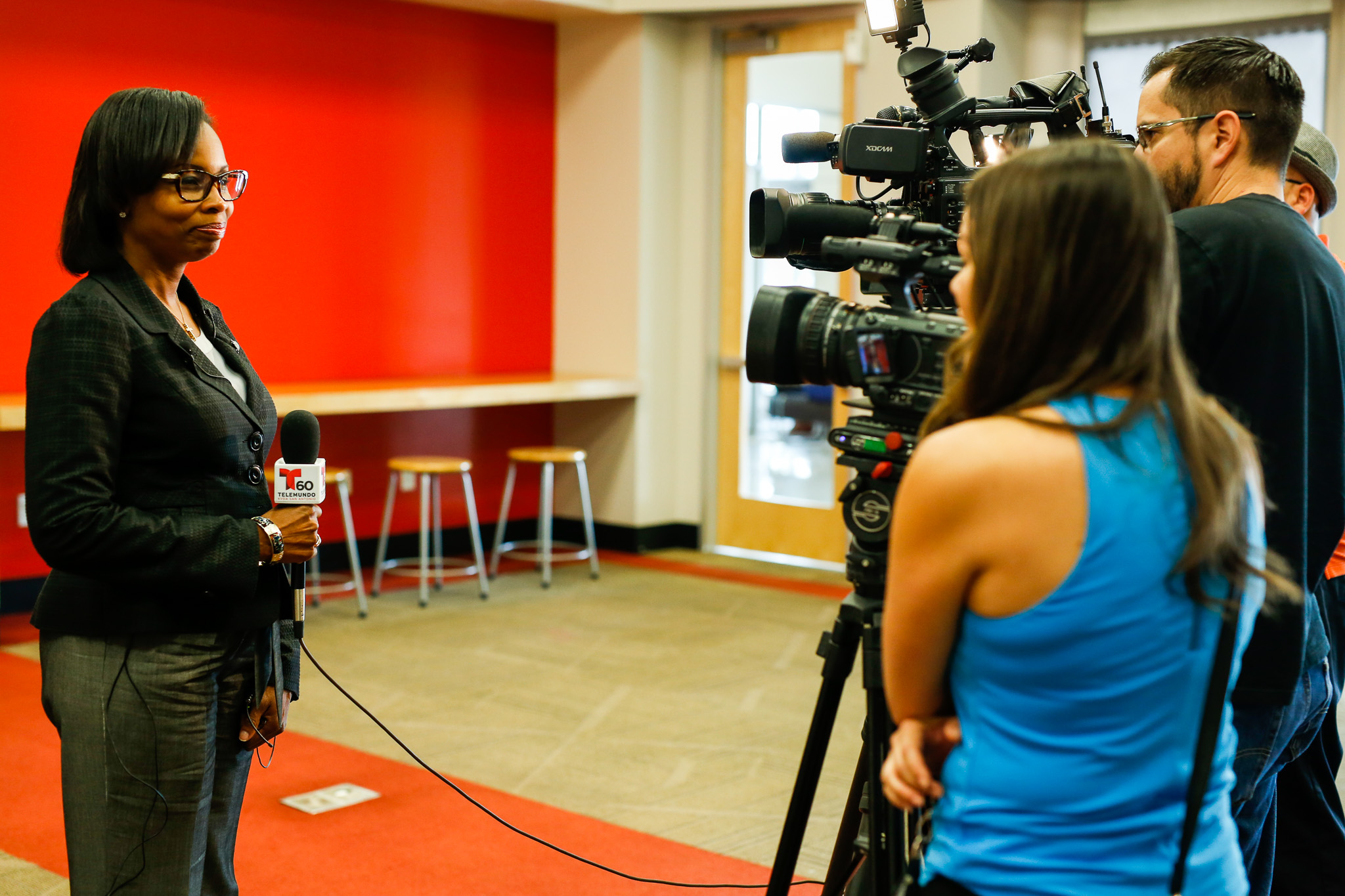 Mayor Ivy Taylor gives an interview to television stations following her presentation. Photo by Scott Ball.
