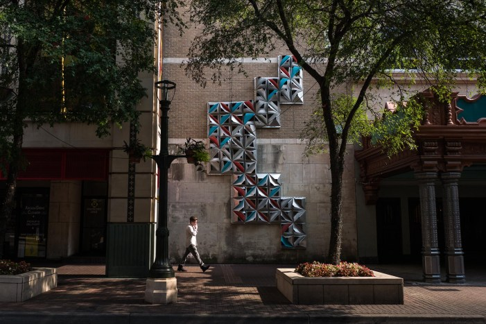 A pedestrian passes by the public art installation titled 'Morf' created by the UTSA College of Architecture. Photo by Scott Ball.