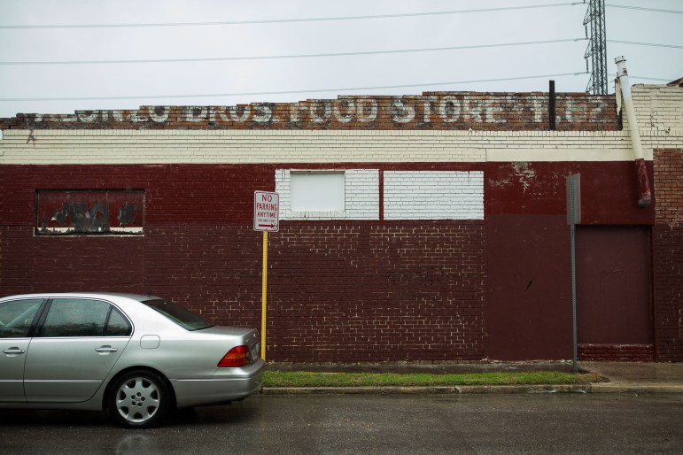 The remnants of an old food store at 1302 S. Flores St. as seen from Sweet Street. Photo by Scott Ball.