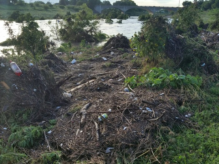 Trash and debris along the Mission Reach following the June 2, 2016 storms. Photo courtesy of the San Antonio River Authority.