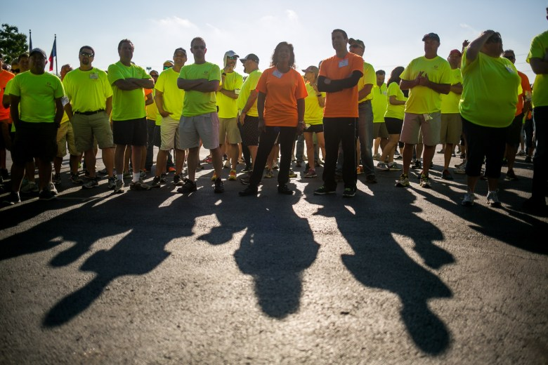 Over 200 H-E-B volunteers gather at Lincoln Park before heading to the work project sites. Photo by Kathryn Boyd-Batstone.