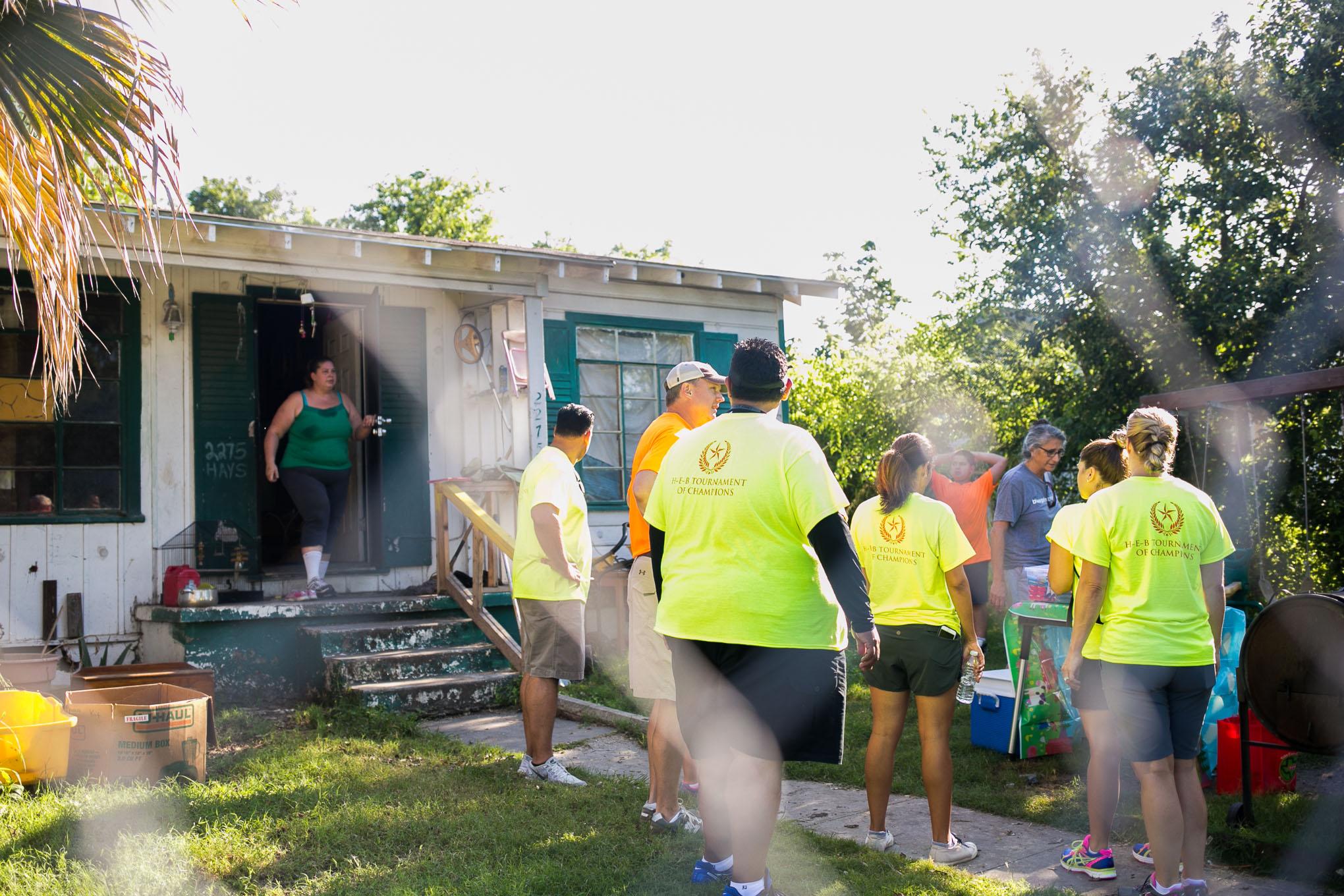 Jennifer Miller exists her home as H-E-B volunteers begin renovations. Photo by Kathryn Boyd-Batstone