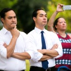 From left: U.S. Department of Housing and Urban Development Secretary Julián Castro and U.S. Rep. Joaquín Castro (D-Texas) listen to city officials speak at the candle light vigil. Photo by Kathryn Boyd-Batstone
