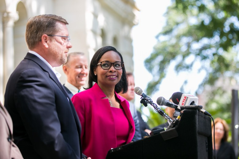 Mayor Ivy Taylor looks to SAPOA President Mike Helle during the announcement of the new labor contract with the police union. Photo by Kathryn Boyd-Batstone.