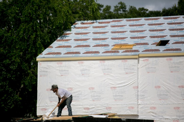 Construction workers start to build up the frames of the 32 single-family homes. Photo by Kathryn Boyd-Batstone.
