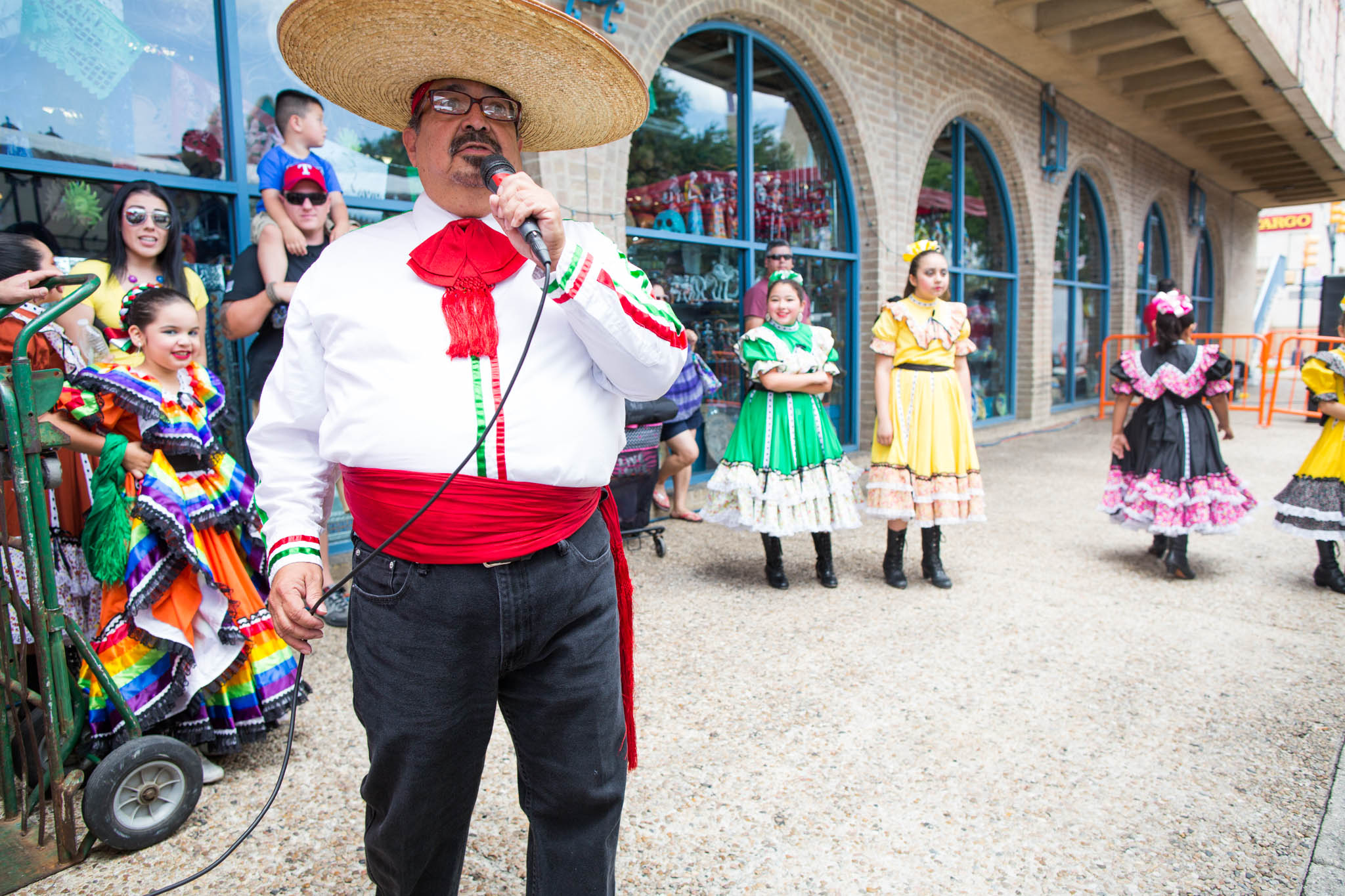 The Ballet Folklorico is announced before their performance at the Family Pride Fair at Market Square. Photo by Michael Cirlos.
