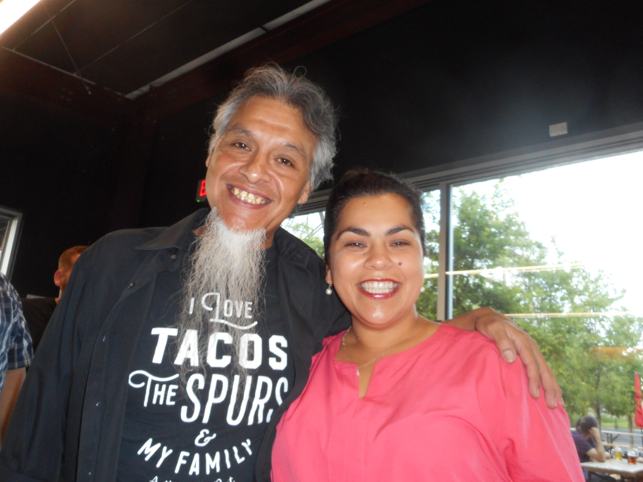 Anthony the Poet & City Councilwoman Rebecca Viagran make plans for the Canto San Antonio poetry slam. Photo by Don Mathis.