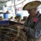 James Carthel builds a basket. Photo courtesy of the Texas Folklife Festival.