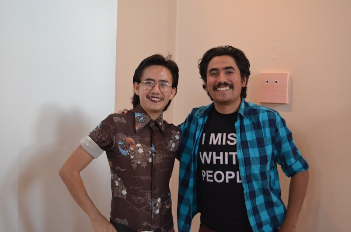 (From left:) Michael Martinez and his brother, Mark Anthony, pose for a photo at the opening of their joint-exhibition Profiling Made Visible. Photo by Camille Garcia.