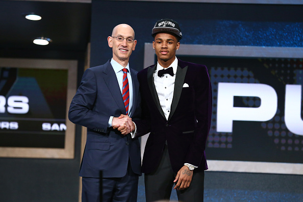 Dejounte Murray shakes hands with NBA Commissioner Adam Silver after being selected number twenty ninth overall by the San Antonio Spurs during the 2016 NBA Draft on June 23, 2015 at Barclays Center in Brooklyn, New York. Photo by Nathaniel S. Butler /NBAE via Getty Images.