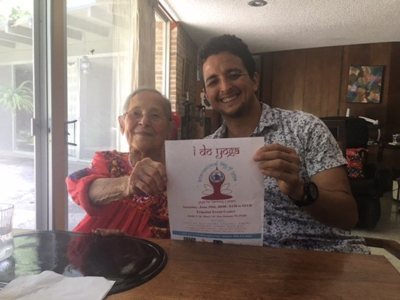Esther Vexler and Yoga Day founder Carlos Gomez promote the International Day of Yoga. Photo courtesy of Yoga Day.