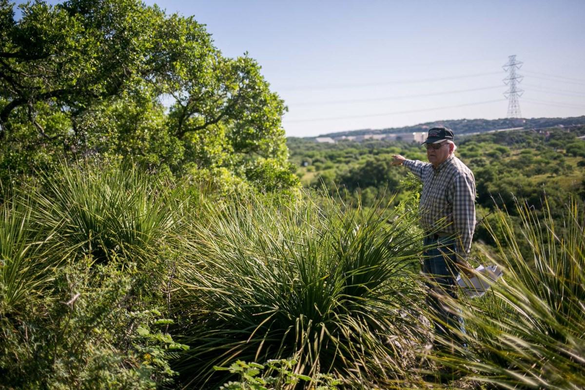 Chairman of the Stone Oak Neighborhood Association Art Downey points to a trail. Photo by Kathryn Boyd-Batstone.