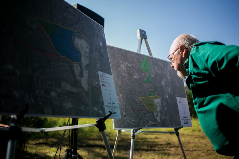 Constantine Klufas looks at the renderings of the proposed land purchase. Photo by Kathryn Boyd-Batstone.