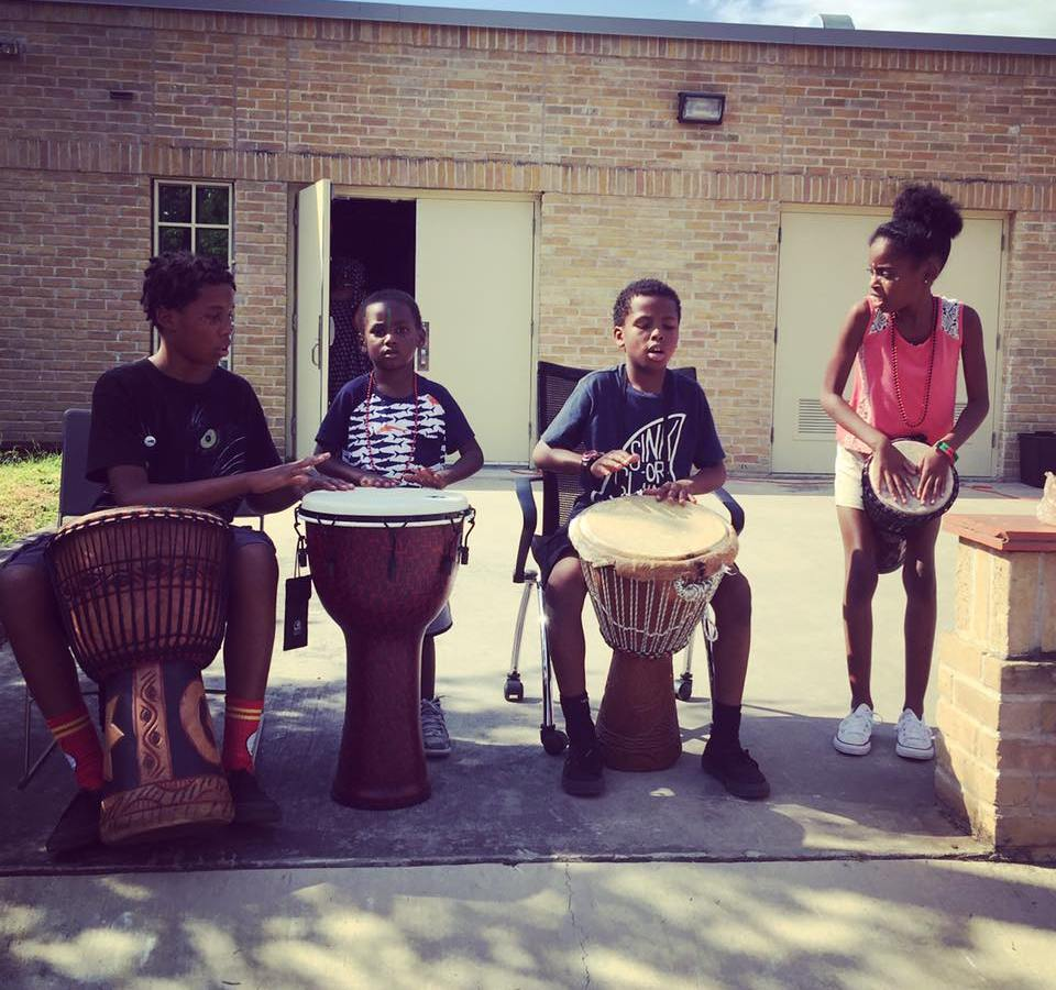 Children play the drums during the First Annual PACF of San Antonio.