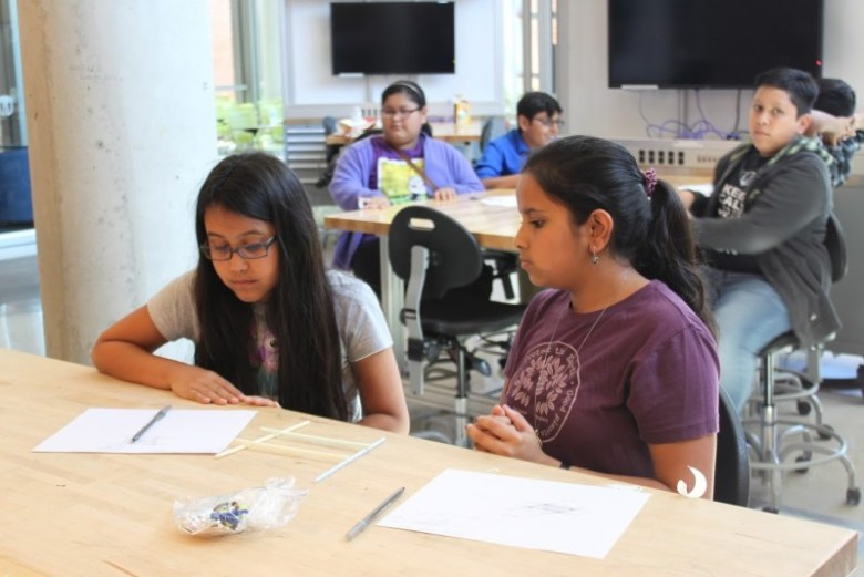 Two students sit inside Trinity University's Center for the Sciences & Innovation building. Photo courtesy of the San Antonio Youth Leadership Program.
