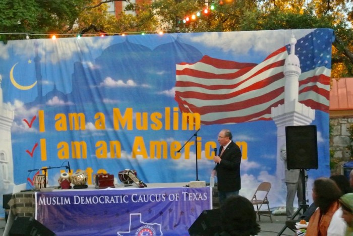 Texas Democrats Chair Gilberto Hinojosa speaks to the audience at the Muslim Democratic Caucus party Thursday evening.  Photo by Sarah Talaat.