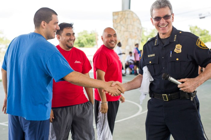 San Antonio Police Department Chief William McManus shakes hands with Chris De Leon before a game. Photo by Scott Ball.