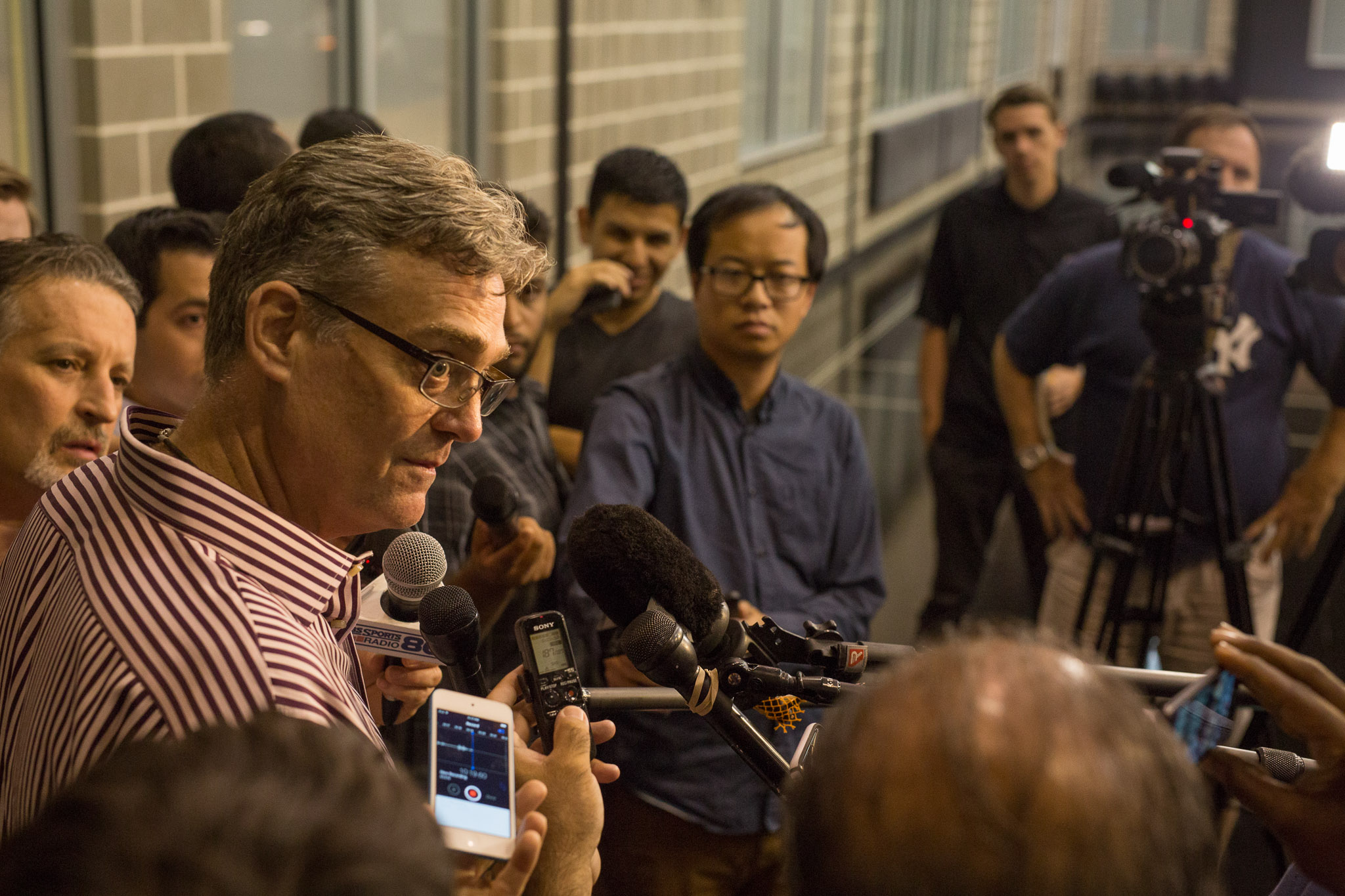 San Antonio Spurs General Manager RC Buford is interviewed by reporters after the announcement of the 29th draft pick Dejounte Murray. Photo by Scott Ball.