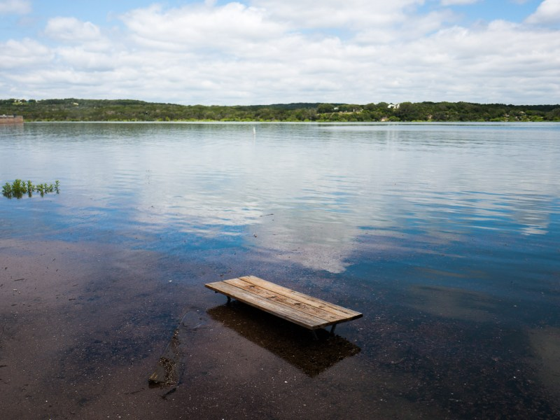 A picnic table is flooded by the amount of water Medina Lake has received over the past months. Photo by Scott Ball.